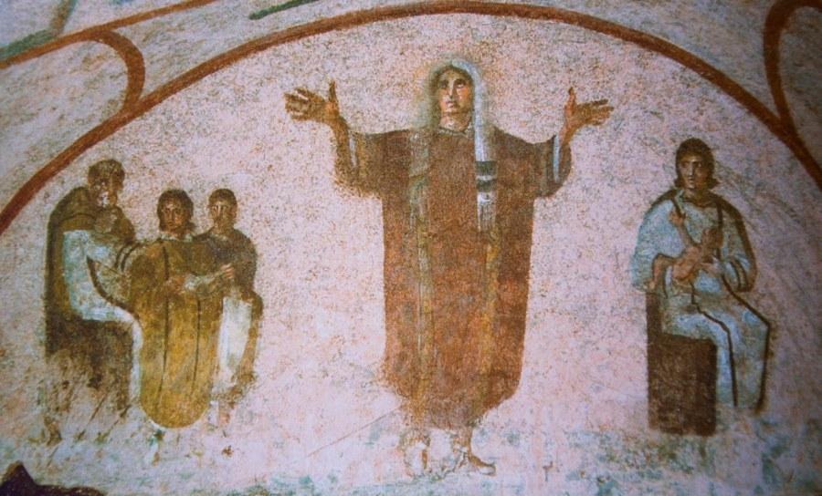 上图:主后三世纪的百基拉墓穴壁画,描绘早期教会的妇女在祷告时蒙头。罗马的百基拉地下墓穴(catacomb of priscilla)在第二世纪后期到第四世纪被用于基督徒的葬礼。